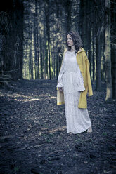 Woman standing in a forest - VTF000226