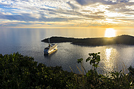 Croatia, Dubrovnik, view to cruise liner Costa Fascinosa in front of Lokrum Island at evening twilight - WE000077