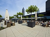 Germany, Hesse, Frankfurt, Roof terrace with restaurant and Messeturm in background - AM002238