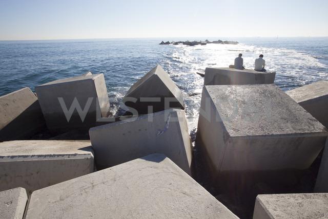 Spain, Catalonia, Barcelona, Stones at beach - MKL000018