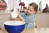 Portrait of little girl stirring dough with mixer - ECF000624