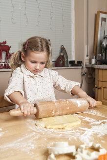 Portrait of little girl rolling out dough - ECF000631