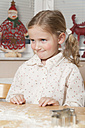 Portrait of little girl sitting at kitchen table - ECF000634