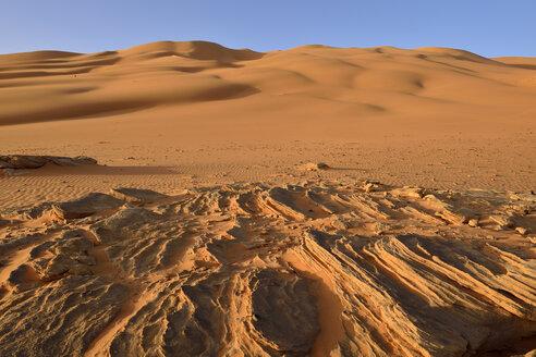 Africa, Algeria, Sahara, Tassili N'Ajjer National Park, Tadrart, Sand dunes and sandstone rocks at Oued In Djerane - ES001119