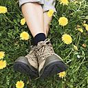 Germany, Eifel, walkers, woman engaged in flower meadow, dandelion (Taraxacum), Spring - GWF002758