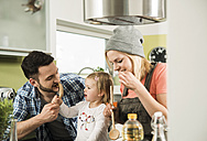 Family cooking in kitchen at home - UUF000473