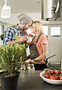 Couple in love cooking in kitchen at home - UUF000525