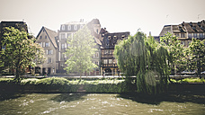 France, Alsace, Strasbourg, L'ill River, View of waterfront - SBDF000904