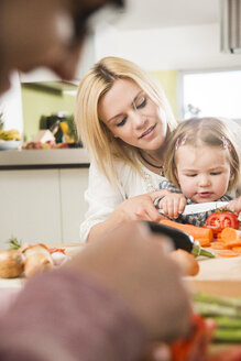 Family cooking in kitchen at home - UUF000477