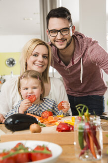 Portrait of family cooking in kitchen at home - UUF000524