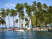 Caribbean, St. Lucia, Boats on beach in Marigot Bay - AM002243