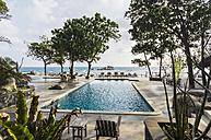 Indonesia, Riau Islands, Bintan, Nikoi Island, Sun loungers at hotel pool - THA000347