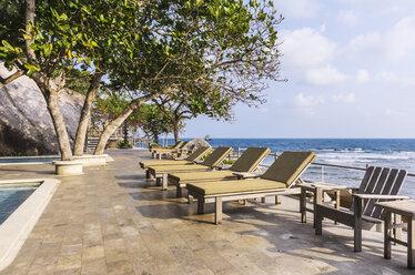 Indonesia, Riau Islands, Bintan, Nikoi Island, Sun loungers at hotel pool - THA000350