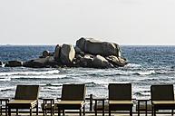 Indonesia, Riau Islands, Bintan, Nikoi Island, Sun loungers by the sea - THAF000351