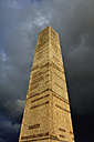 Germany, Bavaria, Stone obelisk with dark clouds - AX000672