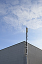 Germany, Bavaria, Ottendichl, Transmitter mast on a grey house front - AXF000676