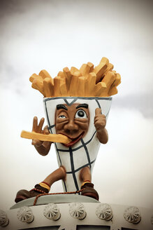 Germany, funny advertisment for French fries at fair - HOHF000807