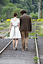 Bridal couple jon the move, back view - ND000472