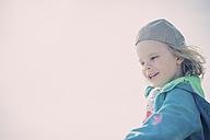 Germany, Mecklenburg-Western Pomerania, Ruegen, Happy boy wearing cap outdoors - MJF001258