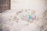 Germany, Mecklenburg-Western Pomerania, Ruegen, Boy on sandy beach - MJF001183