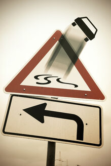 Germany, Road signs, Car loosing control on slippery road - HOHF000813