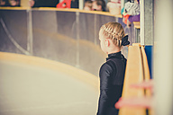 Young female figure skater waiting on ice rink - MJF001274