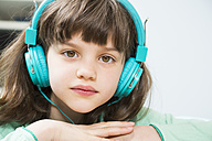 Portrait of little girl with headphones - LVF001304