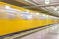 Germany, Berlin, subway station Hohenzollernplatz with moving underground train - NKF000136