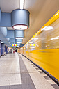 Germany, Berlin, subway station Nauener Platz with moving underground train - NKF000141
