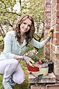 Portrait of woman working in the garden - VTF000234