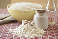 Ingredients of yeast dough and bowl of raw yeast dough on cloth - SABF000015