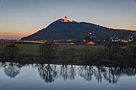 Germany, North Rhine-Westphalia, Porta Westfalica, lighted Emperor-Wilhelm monument at Wiehen hills with Weser river in front - PA000660