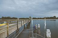 Germany, Mecklenburg-Western Pomerania, Boltenhagen, Baltic Sea, Landing stage in the evening, Boy at steps - MEMF000111