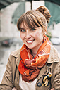 Portrait of smiling woman with freckles wearing orange scarf - MFF001100