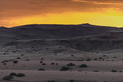 Africa, Namibia, Damaraland, view to grassland and volcanos by sunset - HLF000605