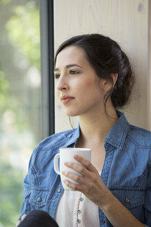 Portrait of creative business woman having coffee break - FKF000552
