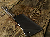 Kitchen cleaver lying on wood - SRSF000505