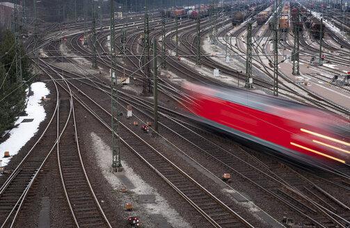 Germany, Hamburg, view to railway yard and driving train - RJ000157