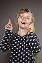 Portrait of little girl using carrot as a phone - OJF000020