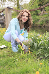 Young woman working in the garden - VTF000261