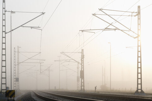 Germany, Hamburg, railway track in early morning fog - MSF003982