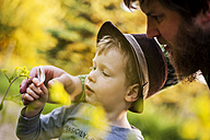 Portrait of little boy exploring nature with magnifying glass - PA000689