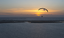 France, Aquitaine, Gironde, Pyla sur Mer, Dune du Pilat, paraglider over Atlantic Ocean at sunset - JB000107