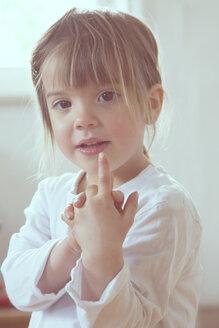 Portrait of little girl showing forefinger - LVF001341