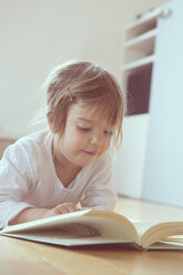 Portrait of little girl with book - LVF001343