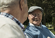 Portrait of happy old man having fun with his friend - UUF000677