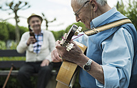 Two old men with guitar in the park - UUF000704