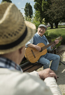 Two old men with guitar in the park - UUF000705