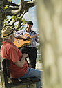 Germany, Rhineland-Palatinate, Worms, two old men with guitar at promenade of Rhine River - UUF000729