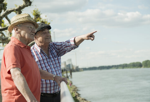 Germany, Rhineland-Palatinate, Worms, two old men looking at Rhine River - UUF000733